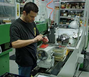 Delta employee making precision measurements.